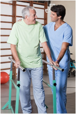 http://www.123rf.com/photo_14172280_senior-man-having-ambulatory-therapy-with-his-therapist.html